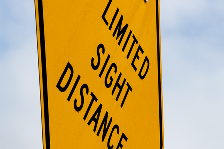 Abstract limited sight distance sign with sky Stock Photo
