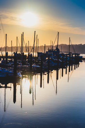 Morning sunrise harbor with hazy filtered light and shadows Stock Photo