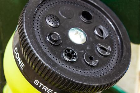 Black plastic garden hose adjustable sprinkler head sprayer nozzle