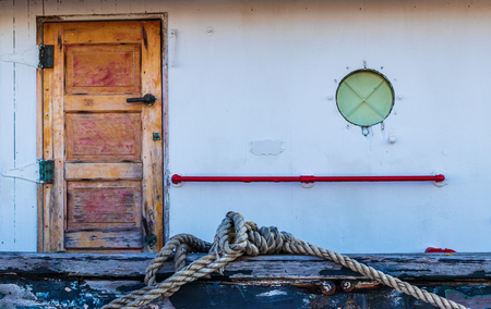 Boat rigging rope tied and secured on white vessel