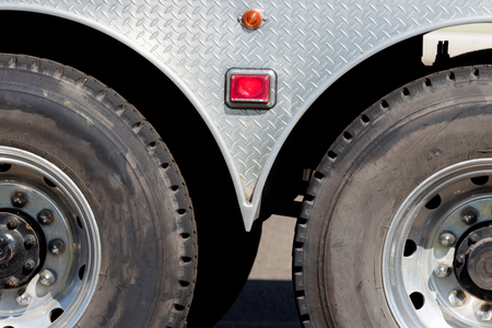 Industrial truck trailer axle tires and wheels in sunlight Stock Photo