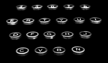Vintage antique typewriter keys on a black background isolated