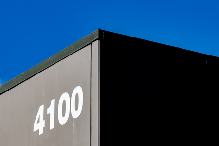 Abstract building corner with blue sky and the number 4100 Stock Photo
