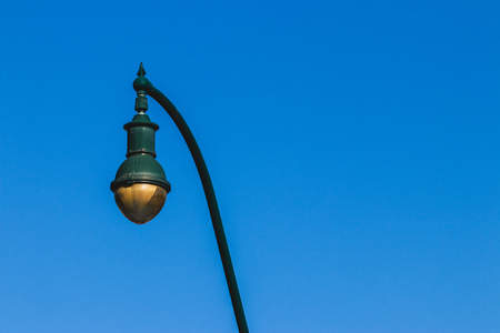 Old fashioned retro street lamps against a blue sky in the summer