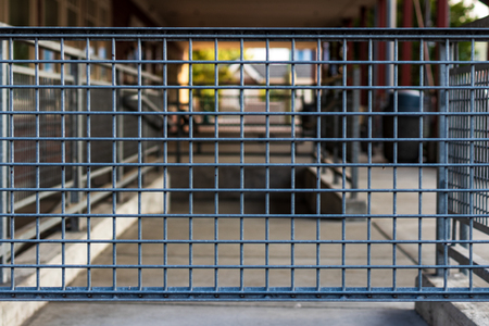 Abstract building exterior view through a steel fence Stock Photo