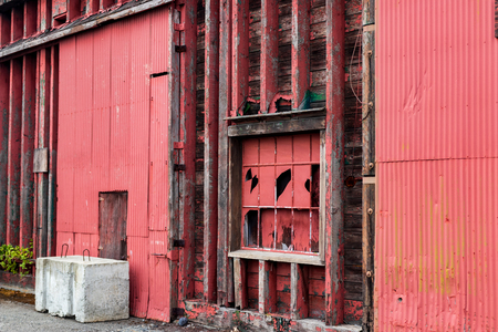 Abstract old red warehouse building wall in daylight Stock Photo