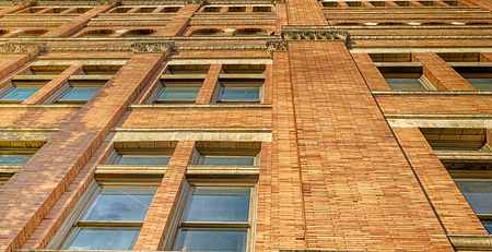 Abstract building wall with windows in daylight Stockfoto