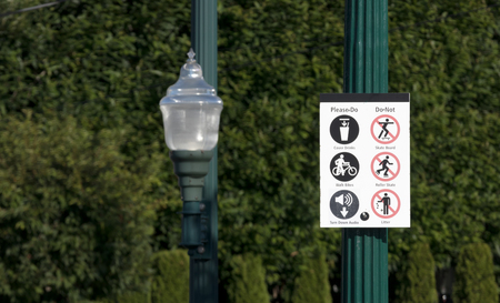 Please do please don't sign next to a street lamp in daylight