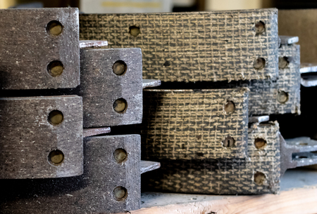 Vintage antique automotive remanufactured brake shoe linings stacked
