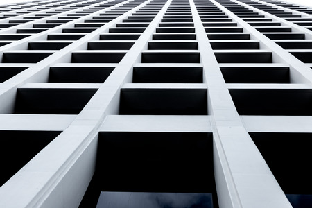 Abstract skyscraper looking up from street level with windows