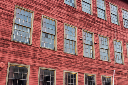 Abstract abandoned old red warehouse building with windows Stockfoto