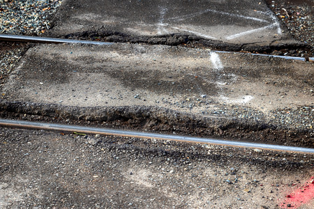 Railroad steel metal rails sunken into the concrete