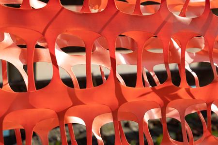 Orange plastic construction barrier fence abstract Reklamní fotografie
