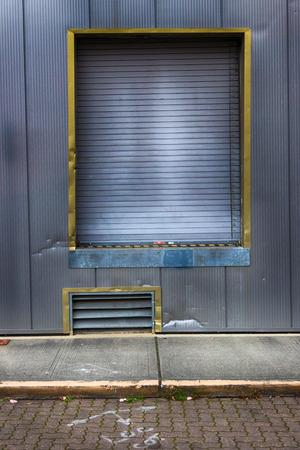 Warehouse loading dock with garage door in daylight