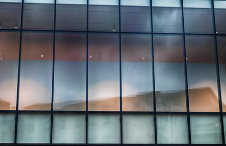 Abstract building window glass with light blue reflections in daylight Stock Photo