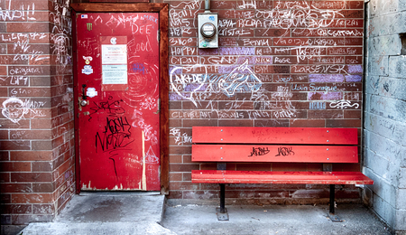Brick wall with bench and a graffiti wall with a power meter