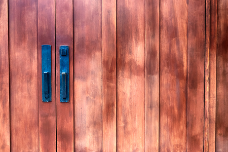 Antique building double doors with faded paint in daylight Stock Photo