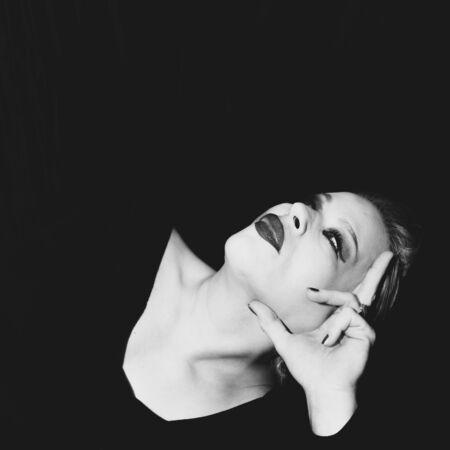 Classic timeless elegant model posing for vintage shoot in black and white