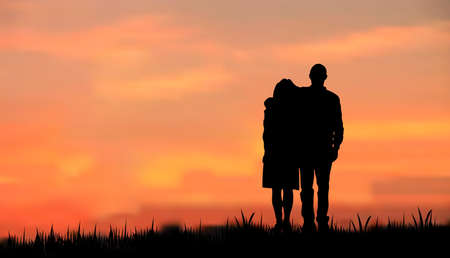 couples as a silhouette, walking on grass in the eveningmorning against sunsetsunrise
