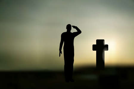 cargo pants: Silhouette of an army soldier saluting on hills against sunset and a grave  Illustration