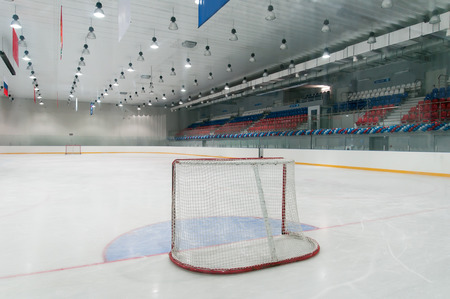 view from behind: empty ice hockey playground - the view from behind the gate