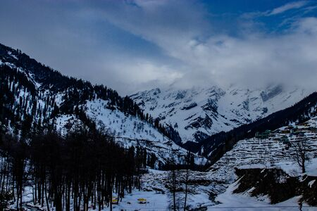 Snow at hills with tree and sky image is taken at manali india showing its amazing natural view.