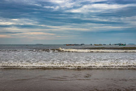 beach view with sea waves at early in the morning from low angle image is take at murdeshwar karnataka india at early morning. it is the very holy as well as touristic place in karnataka. Stock fotó