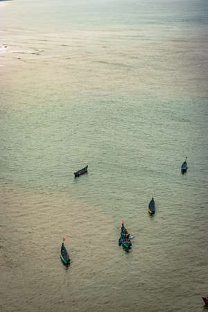 fishing boats isolated many in deep sea aerial shots image is take at murdeshwar karnataka india at early morning. it is the very holy as well as touristic place in karnataka.