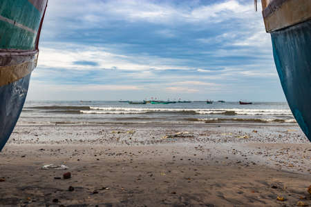 beach view with fishing boats at early in the morning from flat angle image is take at murdeshwar karnataka india at early morning. it is the very holy as well as touristic place in karnataka.