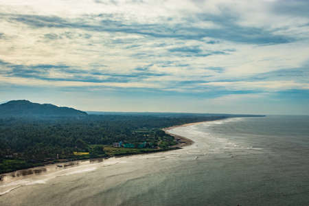 beach serene isolated aerial shots with dramatic sky image is take at murdeshwar karnataka india at early morning. it is the very holy as well as touristic place in karnataka. Stock fotó