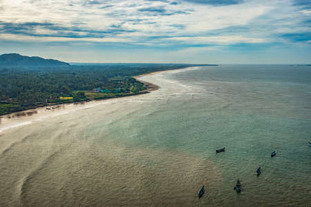 beach isolated with fishing boats aerial shots with dramatic sky image is take at murdeshwar karnataka india at early morning. it is the very holy as well as touristic place in karnataka. Stock fotó