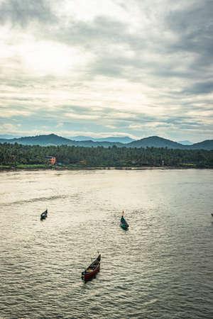 fishing boats in the sea aerial shots at early morning image is take at murdeshwar karnataka india at early morning. it is the very holy as well as touristic place in karnataka.