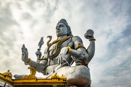 shiva statue isolated at murdeshwar temple close up shots from unique low angle image is take at murdeshwar karnataka india at early morning. it is one of the tallest shiva statue in the world. Stock Photo