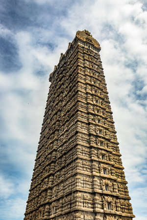 murdeshwar temple rajagopuram entrance with flat sky image is take at murdeshwar karnataka india at early morning. it is one of the tallest gopuram or temple entrance gate in the world.