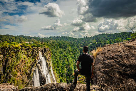 man watching the beautiful jog falls image is taken at jog waterfall karnataka india. it is the third highest waterfall in india. the beauty of this place is serene and mesmerizing.
