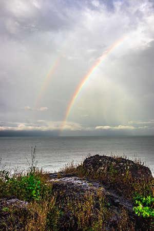rainbow colorful above sea horizon at dawn image is taken at gokarna karnataka india. it is showing the colorful art of nature. 版權商用圖片