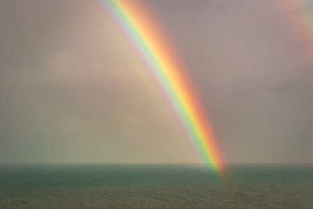 rainbow colorful above sea horizon at dawn image is taken at gokarna karnataka india. it is showing the colorful art of nature. Banco de Imagens