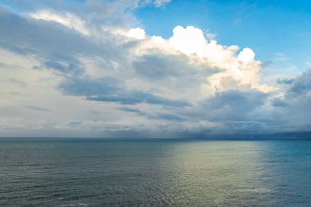 sea horizon view with dramatic cloud at morning image is taken at gokarna karnataka india. it is showing the pristine beauty of gokarna beach from hill top.