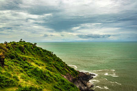 mountain cliff view with sea shore at morning image is taken at gokarna karnataka india.