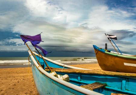 sea shore with boats and amazing sky at morning from flat angle image is taken at gokarna beach karnataka india.