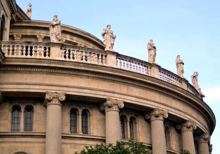 Budapest, Hungary - 09.14.2019: saints, thinkers and warriors - sculptures on the semicircular parapet of an ancient building with columns Editorial