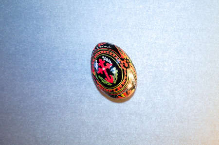 Easter painted egg with the inscription Jesus Christ and the cross for the Easter holiday congratulations with free space for text