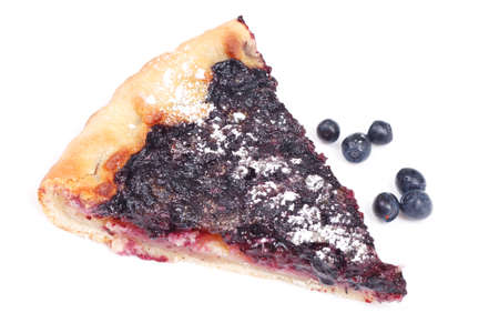 homemade blueberry cake, a piece on white photo