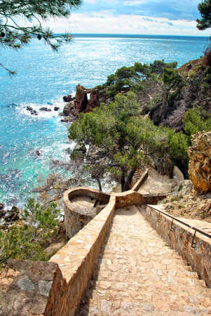 Stairs leading down to the beach on the costa brava in LLoret de mar photo