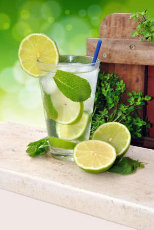 cocktail Mojito made of run,mint and lime in summer terrace Stock Photo - 18685797