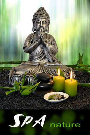Buddha  with massage stones and green clay with candles Standard-Bild