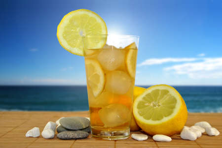 GLASS OF LEMONADE IN BEACH Stock Photo