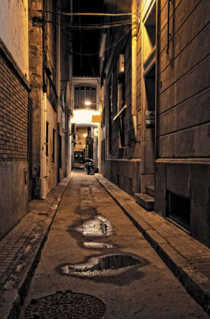 lonely street of the ancient town at night photo