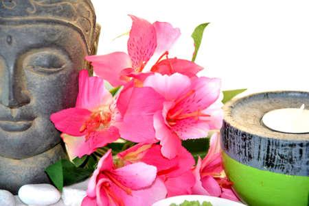massage bath salt with pink flowers and Buddha statue
