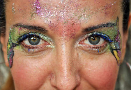 eyeshades: Woman with face painted for carnival and halloween